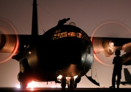 A Hercules C130 Transport Aircraft waits on the tarmac at a Middle Eastern airfield prior to taking off.  This image was a winner in the RAF Photographic Competition 2008 for photographer Sgt Pete Mobbs.