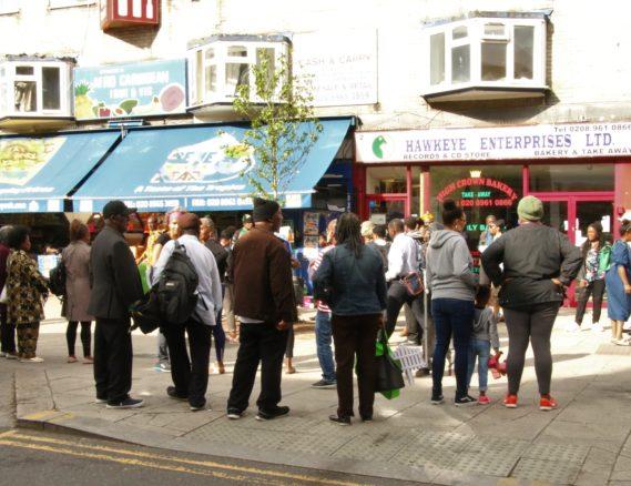 Crowds gathering by Reggae Tree
